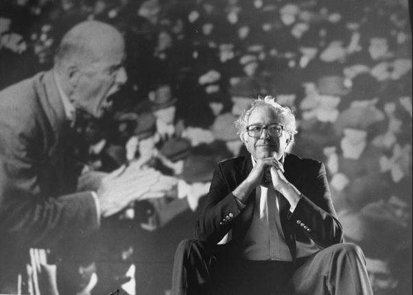 bernie-sanders-in-front-of-image-of-eugene-debs-in-1990-getty-images